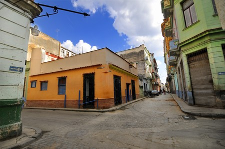 Old Havana street with colorful buildings under blue sky. photo
