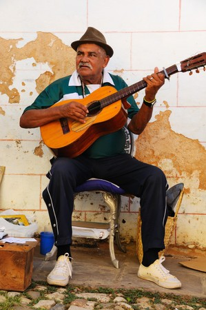 erode: Trinidad, Cuba. Circa OCT 2008. Traditional musicians playing in the street, Trinidad was declared by UNESCO World Heritage Site in 1988