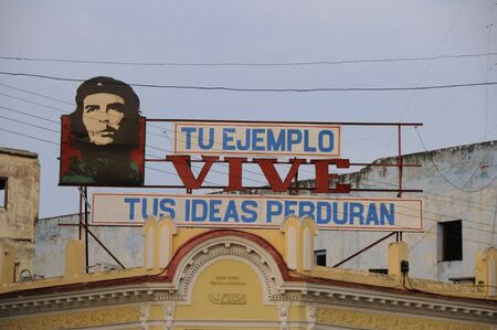 propaganda: Communist propaganda with Che Guevara image in Cienfuegos, cuba. Che became one of the icons of the Cuban Revolution after 1959. Taken circa OCT 2008.