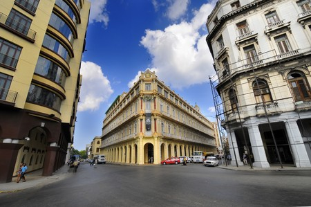 commerce and industry: Havana buildings with historical Hotel Plaza in the background. This is the traditional centre of part of Havanas commerce, industry, and entertainment as well as being a residential area. Taken Circa January 2010 Editorial