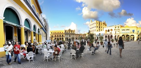 Panoramic view of outdoor cafe in Old Havana plaza vieja, cuba. Taken in november 2008