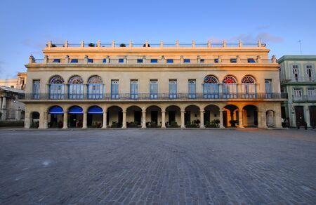 View of tropical building in havana plaza, Hotel Santa Isabel photo