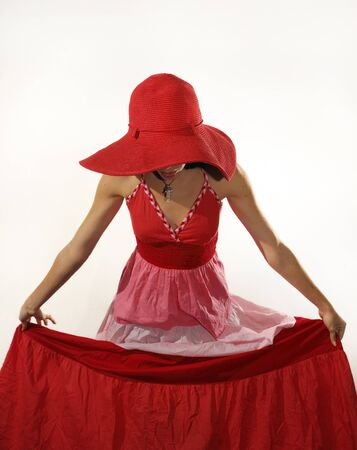 Portrait of young woman wearing red dress and hat isolated photo