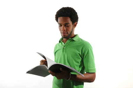 Portrait of young african american man reading a magazine isolated on white 写真素材