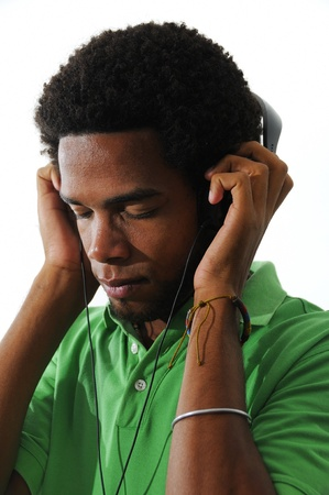 Portrait of young african american man using headphones isolated over white background photo