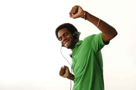 Portrait of cheerful african american guy enjoying music with headphones, isolated on white