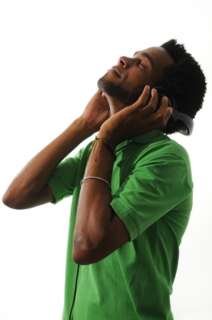 African american guy enjoying music with headphones, isolated over white photo