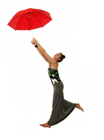 Portrait og young female model holding red umbrella isolated Stock Photo - 12924653
