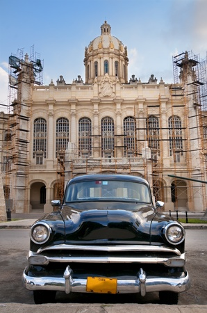 Old american car parked in front of presidential palace, now revolution museum in Havana, Cuba