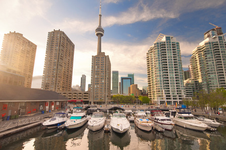 View of the harbour front marina with toronto skyline in the background at sunset photo