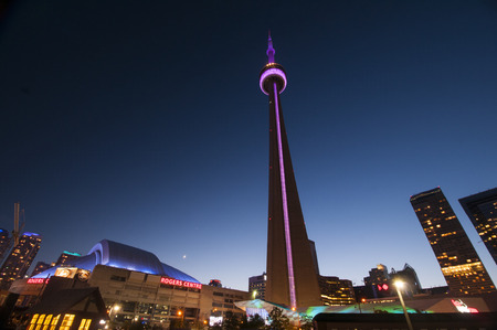 TORONTO, CANADA - MAY 31, 2014  View of the CN Tower and Rogers Center, opened in 1989 as the home of Toronto Blue Jays and is the first to have retractable motorized roof