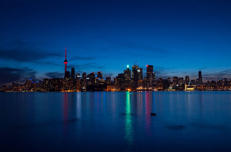 Toronto cityscape at night with reflections over the lake photo