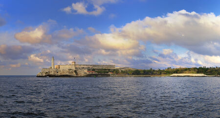 Panoramic view of el morro fortress in havana bay entrance at sunset  photo