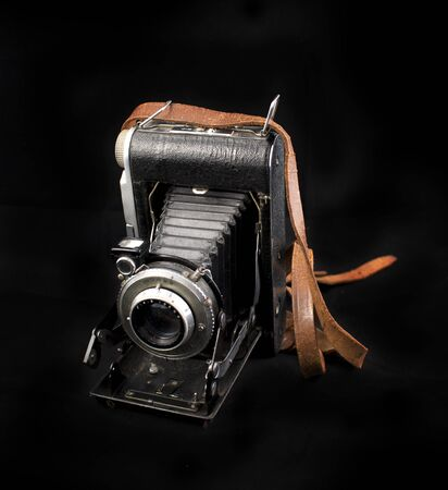 bellows: Vintage analog photo camera with bellows isolated on black background Stock Photo