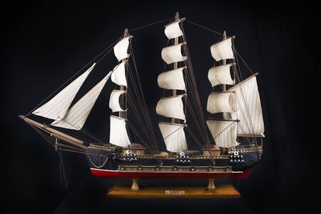 starboard: Highly detailed XVIII century frigate model isolated over black background Stock Photo