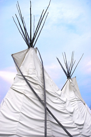 sioux: Detail of Teepee or wigwam topsagainst blue sky Stock Photo