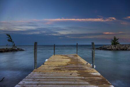 nightfall: Long exposure shot of lake Ontario at sunset from woodbine beach, Toronto, Canada. Stock Photo