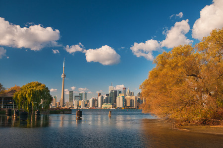 View of Toronto skyline from center island with seasonal autumn trees