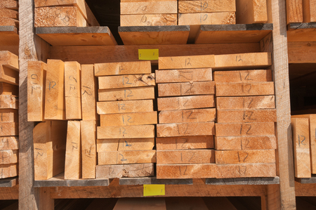 lumber mill: Numbered wood planks stacked at lumber mill in Ontario, Canada