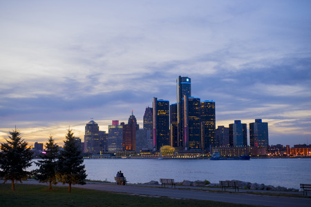 DETROIT, MI-SEPTEMBER, 2015: A view of Detroit skyline with the world headquarters for General Motors Corporation, situated along the Detroit River. Taken at sunset from Windsor, Ontario.