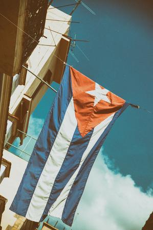 crumbling: Cuban flag waiving from crumbling Havana building Stock Photo