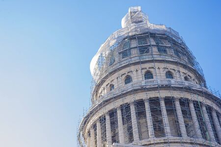 capitolio: HAVANA,CUBA-November 29, 2015: Dome of El Capitolio being repired using scaffolding frames. National Capitol Building was the seat of government until the Cuban Revolution in 1959.