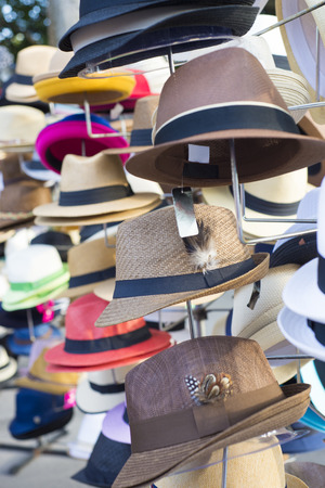 Several assorted hats on display at street festival