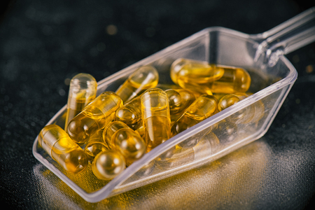 Cannabis extraction capsules infused with shatter isolated over black background Imagens - 67823255