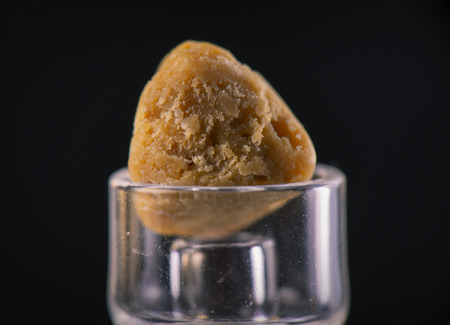 Marijuana extraction concentrate aka wax crumble isolated on black background