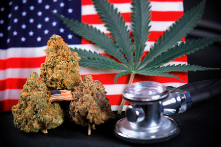 Cannabis bud, leaf and american flag with smoke and copyspace - veteran theme medical marijuana concept Stock Photo