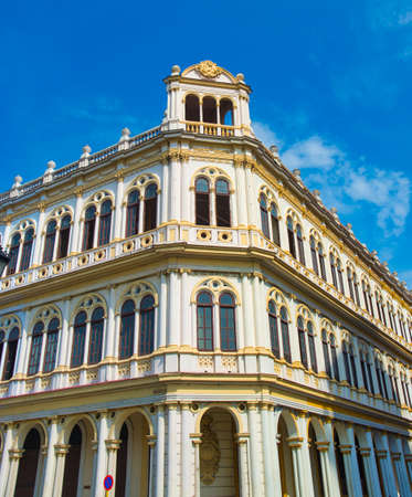 View of typical Old Havana building facade with colonial architecture against blue sky Stock Photo