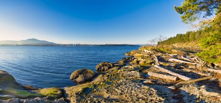 Scenic panoramic view of the ocean overlooking at the Strait of Georgia from Jack Point and Biggs Park in Nanaimo, British Columbia. Stock Photo