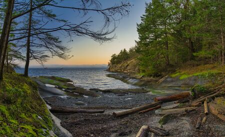 Scenic sunset panoramic view of the ocean overlooking at the Strait of Georgia from Jack Point and Biggs Park in Nanaimo, British Columbia. Stock Photo