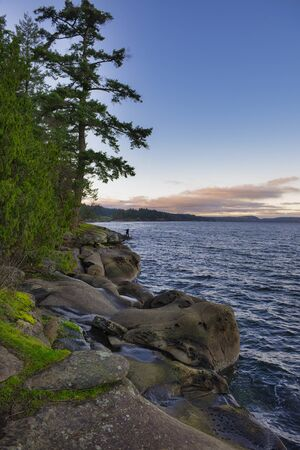 Scenic sunset view of the ocean overlooking the Strait of Georgia from Roberts Memorial Park in Nanaimo, British Columbia. Stock Photo