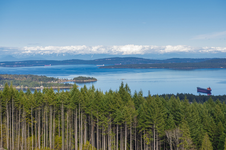 Lookout view of Ladysmith shoreline from top of a mountain and gulf islands in the horizon, taken on Vancouver Island, BC, Canada