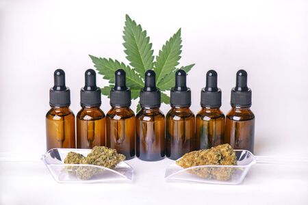 Bottles of cannabis tincture or CBD oil derived from marijuana plant isolated over white background, medical marijuana concept