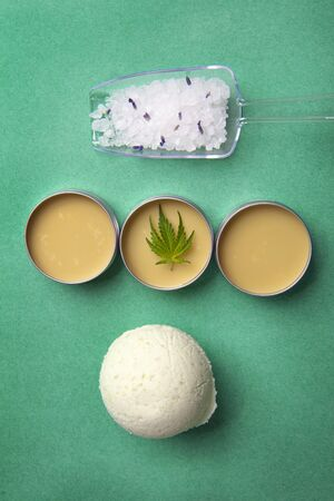 Assortment of cannabis wellness products with bath bomb, soaking salts and marijuana salve - cannabis spa concept Imagens