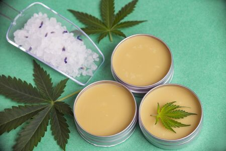 Assortment of cannabis wellness products with bath bomb, soaking salts and marijuana salve - cannabis spa concept Stockfoto