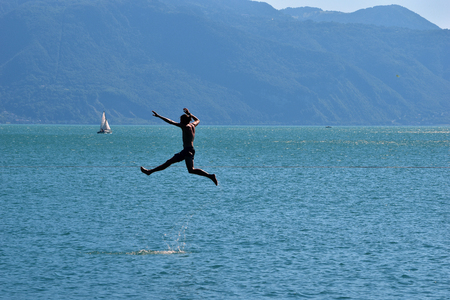 Man doing Slackline over water in a lake