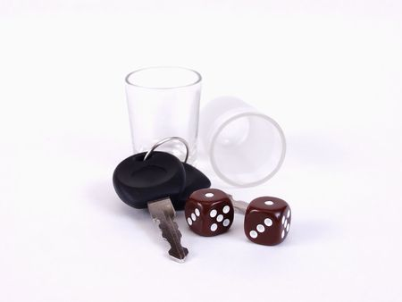 Empty shotglasses, dice, and a pair of car keys. Drinking and driving, what a gamble!