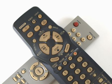 vcr: Two remote controls for VCR and CD player isolated over white.
