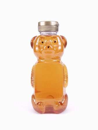 A full Honey Bear Bottle and silver cap isolated on a white background Stock Photo