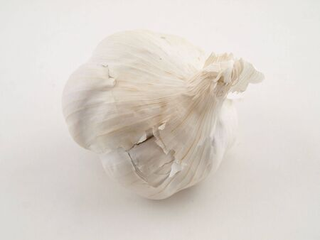 A whole clove of garlic isolated on a white background
