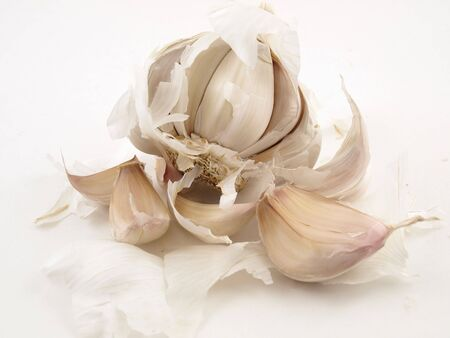 A white clove of Garlic broken open and isolated on a white back ground