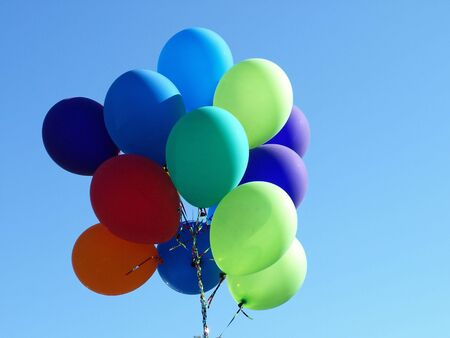 A colorful group of Balloons floating along the sky photo