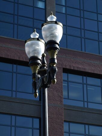 Electric Lamp post outside of a modern styled building.