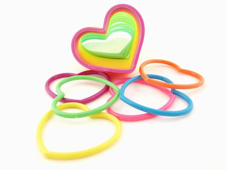 slinky: Assortment of colorful hearts and a slinky isolated on a white background
