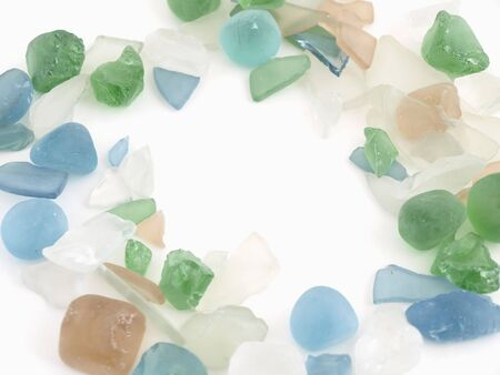 Colorful stones of glass in various blue tones isolated over a white background.