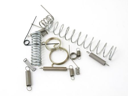 A set of miscellaneous wire springs isolated on a white background.