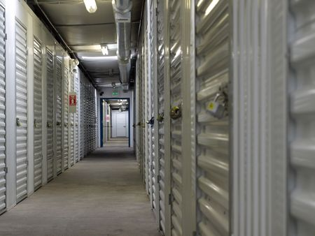 Interior hallway in a self storage unit facility. Natural lighting, interior shot Stock Photo